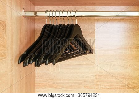 Empty Black Clothing Rack Hanging On Coathanger In Closet With Copy Space