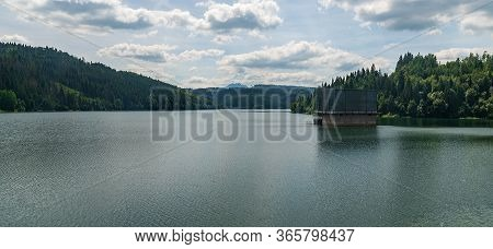 Nova Bystrica Water Reservoir With Hills Around In Slovakia During Nice Summer Day With Blue Sky And