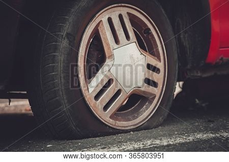 Deflated Car Wheel (tire) On Wrecked Car - Forgotten Car On Street Concept