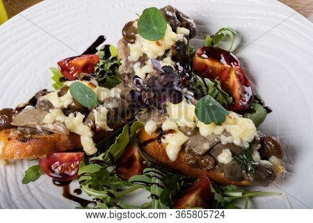 Crostini With Sautéed Forest Mushrooms, Garlic, Basil And Mozzarella.traditional Italian Antipasti A