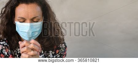 Christian Worship And Praise. A Young Woman Is Praying And Worshiping With Protection Mask. Worship