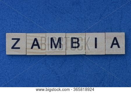 Name Of The Country Of Zambia From The Word From Gray Wooden Letters On A Blue Table