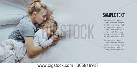 Mother And Daughter Sleep In Bed, Top View With Copy-space. Concept Of Security, Protection, Comfort