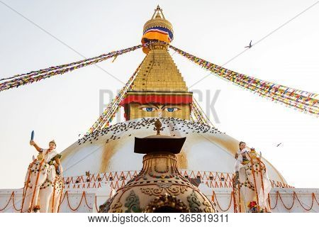 Sacred Boudhanath Buddhist Stupa With Prayer Flags In Kathmandu. Famous Buddhist Stupa In The World