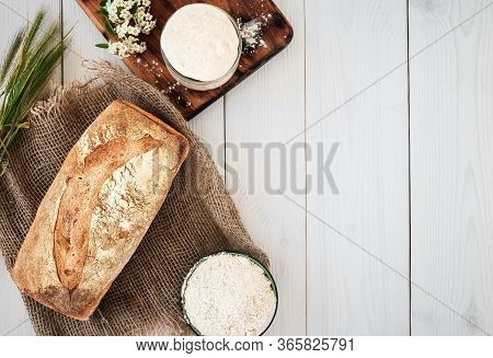 Sourdough For The Preparation Of Bread, Flour And Freshly Baked Bread On A White Wooden Table. Hobbi