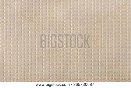 Beige Faux Leather With A Pattern Of Evenly Repeating Small Circles. A Variety Of Textures Of Artifi