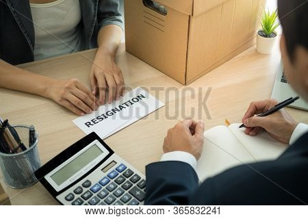 The Business Woman Has A Brown Cardboard Box Next To Her Body And Sends A Letter Of Resignation To T