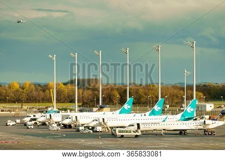 Germany, Munich - Circa 2020: Lufthansa Regional Airline Airplanes Grounded At Munich Airport. Airpl