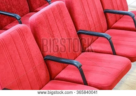Red Chair Close-up.  Rows Seats In Empty Movie Theater. Conference Room Seating.