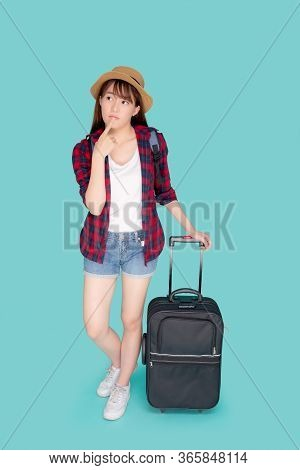 Beautiful Portrait Young Asian Woman Thinking Idea Travel In Vacation With Luggage Isolated On Blue