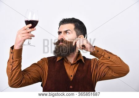Barman With Curious Face Looks At Italian Alco Drink