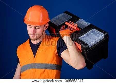 Worker, Repairer, Repairman, Strong Builder On Thoughtful Face Carries Toolbox On Shoulder, Ready To