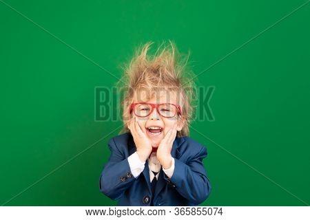 Bright Idea! Happy Child Student Against Green Chalkboard