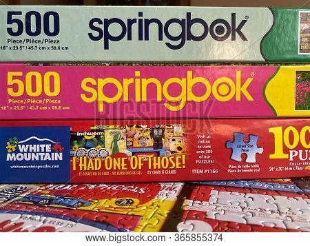Woodbridge, New Jersey / Usa - May 11, 2020: Multiple Jigsaw Puzzles Are Stacked On Top Of A Complet