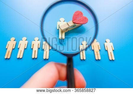 The Chosen Person Among Others. A Human Figure Of Wooden Stands Out From The Crowd. Wooden Figures O
