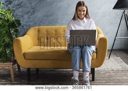 Young Woman Holding Laptop, Surfing Internet, Looking For Useful Content For Education And Work. Fre