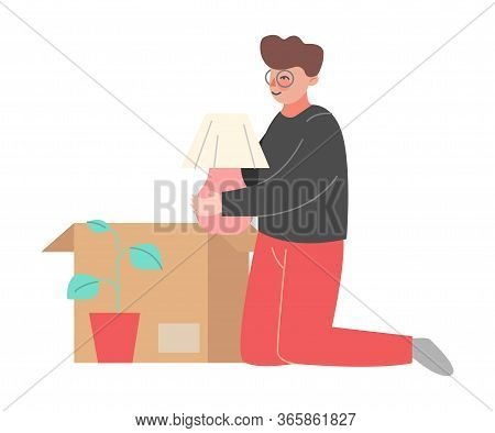 Young Man Packing Or Unpacking Belongings In Cardboard Box, Guy Relocating To New Home Vector Illust
