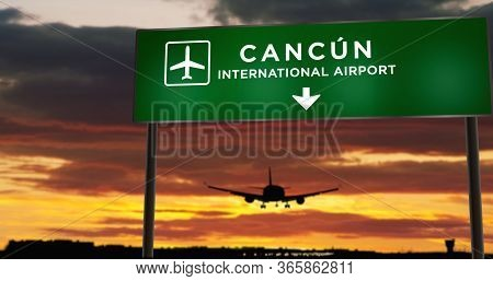 Airplane Silhouette Landing In Cancún, Mexico (cancun). City Arrival With Airport Direction Signboar