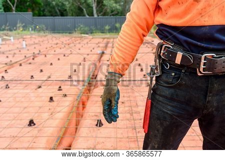 Australian Steel Fixing Worker Equipped With Tools Standing On Construction Site On A Day
