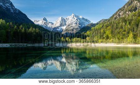 Jasna Lake At Kranjska Gora In Slovenia, Europe On A Beautiful Spring Morning.