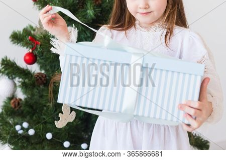 Holidays, Presents, Christmas, X-mas Concept - Close-up Of Child Girl Opens Gift Box.