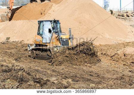 Kirishi, Russia - 8 May, Medium Bulldozer At Site Planning Works, 8 May, 2020. Start Of Construction
