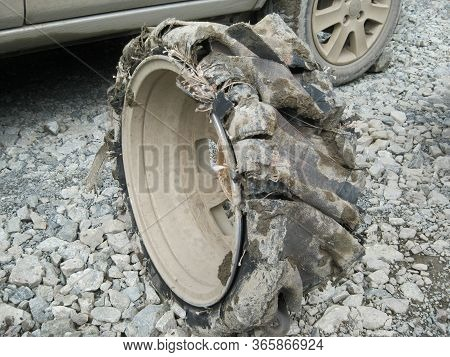 Pierced Wheel Traveled On Crushed Stone. Car Wheel Is Broken, Flat Tire, Drove A Few Minutes On A Br