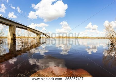 Road Bridge Across The Volkhov River. Spring View Of The Province On A Sunny Day.