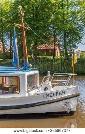 Bow Of A White Ship With The Name Of The City Meppen In The Canal Of Haren, Germany