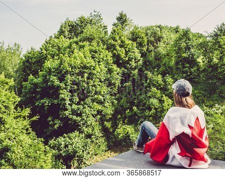 Cute Woman Holding Canadian Flag. National Holiday Concept