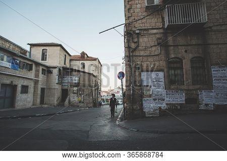 Jerusalem, Israel - October 13, 2013: Orthodox Jewish Man In Traditional Suit Walking On Mea Shearim