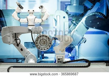 Industrial Robotic Gripping And Smart Robot Working On Smart Factory, On Machine Blue Tone Color Bac