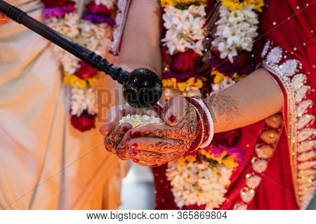 Hindu Bride And Groom Held Ghi In Their Hands, Participating In The Wedding Ritual. Beautiful Tradit