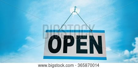 COVID-19 end of confinement stores reopening with OPEN sign hanging on window store front banner background. Retail businesses opening for non essential services.