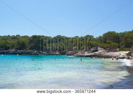 Little Beach With Turquoise Sea And Pinewoods Around -  Beautiful Spanish Island