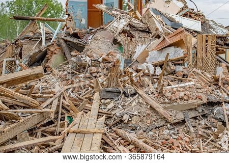 Rubble Of Old Ruined House. Pile Of Construction Fragments In Ruins