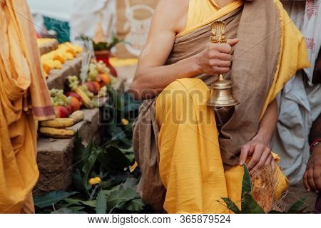 Young Brahman Brahmachari Holds A Bell In His Hands During Yagya A Fire Flame Ritual Of Hindu Pooja