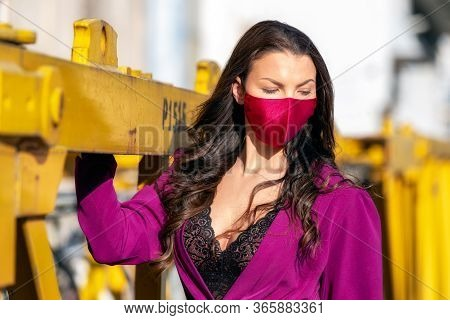 Woman With Neckline Wearing Trendy Violet Fashion Face Mask Due Coronavirus Covid-19 Protection