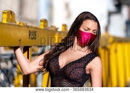 Woman With Breast At Neckline Wearing Luxury Violet Fashion Face Mask