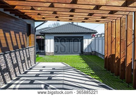 Wooden Canopy In Front Of The Garage