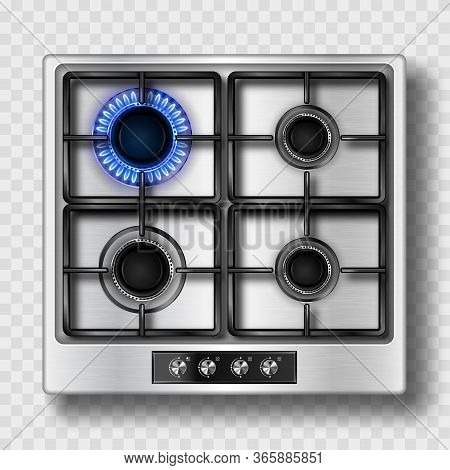 Gas Stove Top View With Blue Flame And Black Steel Grate. Kitchen Burner With Lit And Off Hobs. Real
