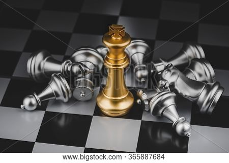 Winner. Gold King Surrounded With Silver Chess Pieces On Chess Board Game Competition With Copy Spac