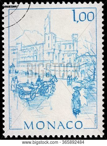 Luga, Russia - April 10, 2020: A Stamp Printed By Monaco Shows View Of The Palace Square In Monte Ca