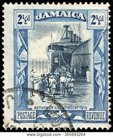 Luga, Russia - April 10, 2020: A Stamp Printed By Jamaica Shows Return Of War Contingent In 1919, Ci