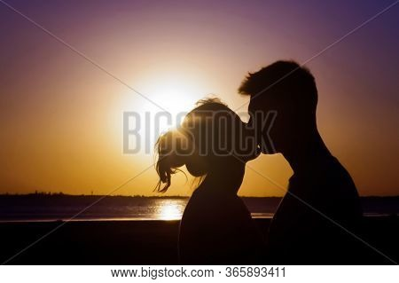 Silhouette Lovers Are Kissing , Twilight, Sunset, Sea Beach, Evening Summer, Young And Happy Couple