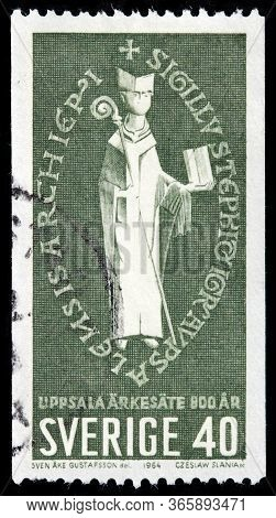 Luga, Russia - April 10, 2020: A Stamp Printed By Sweden Shows The Insignia Of Archbishop Stefan Fro