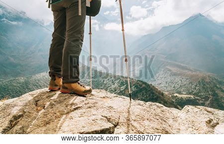 Young Hiker Female Standind In Cliff Edge And Enjoying The Imja Khola Valley During An Everest Base