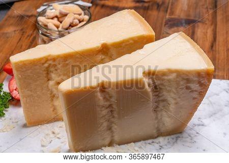 Big Wedges Of Parmigiano-reggiano Parmesan Hard Italian Cheese Made From Cow Milk Or Grana Padano  C