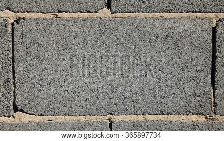 Grey Brick, Texture And Background. Surface And Blank For Inscription. Mock-up. Slag (cinder) Block