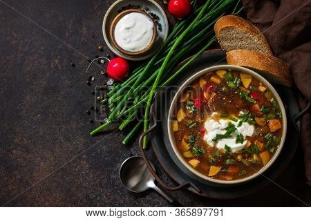 Traditional Dish Russian Cuisine. Cold Summer Okroshka Soup With Kvass, Sausage And Vegetables In A